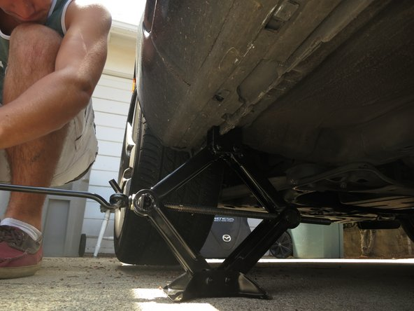 Use the Jack Handle to crank up just enough so that the tire noticeably lifts off the ground.