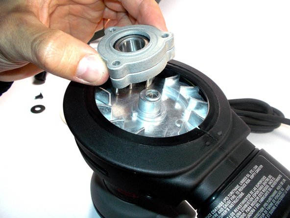 unscrew this bolt using a T20 star bit and carefully remove the washer and bearing as shown.