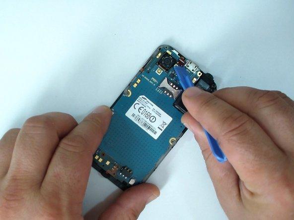 Disconnect the earpiece & light sensor flex cable.