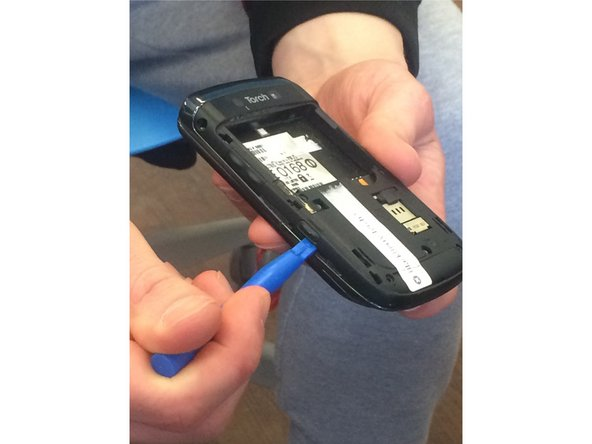 Remove the two screws using the T7 screwdriver.