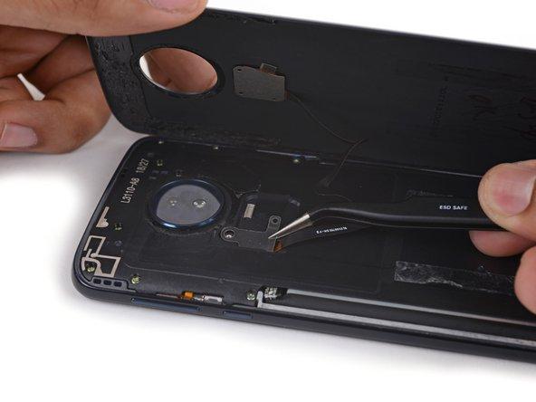Use a pair of tweezers to remove the fingerprint sensor cable retention bracket.