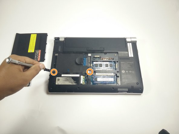 Locate screws holding in the hard drive and remove.