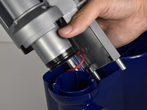 Continue to pull on the grey compartment until it is fully out of the main body of the vacuum.