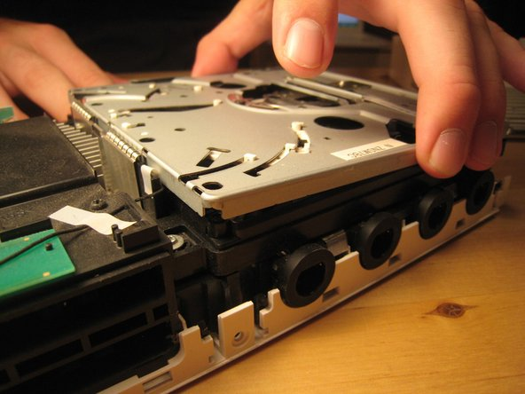 Image 2/3: There are a ton of parts in the optical drive, but there is nothing very fancy about this drive compared to other slot-loading drives, so I didn't take it apart completely. There are also a ton of gears and levers that I did not want to deal with.