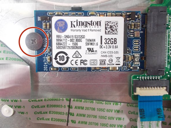 Unscrew the 3 mm PH00 Phillips head screw located on the left side of the SSD.