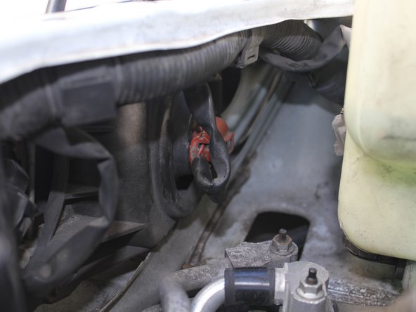 Located right behind the headlight is a red Deutsch connector. Push down on that connector to unplug wiring and rotate unconnected portion counterclockwise, facing from the driver's view, to remove bulb.