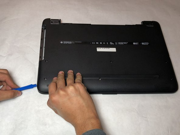 Remove the bottom of the plastic case using a blue plastic opening tool.