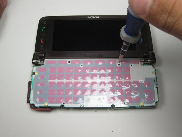 With the T5 Screwdriver, remove the marked screws.