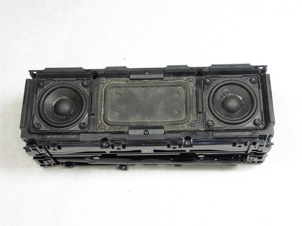 Place the disassembled Jambox with the speakers facing up.