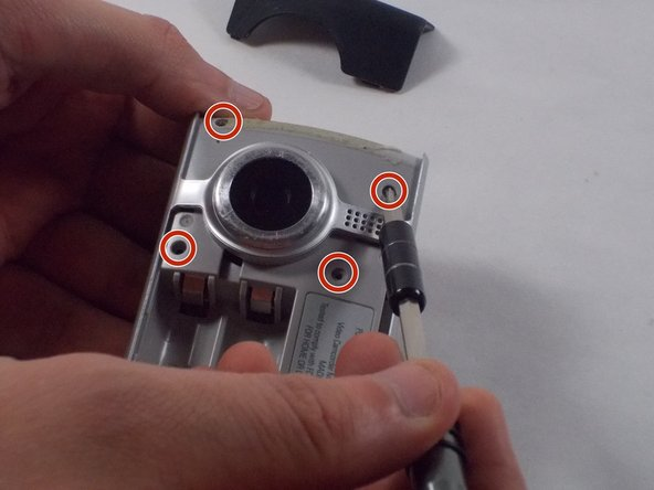Remove the six 1mm screws from front of the camera with the Phillips Head screwdriver.