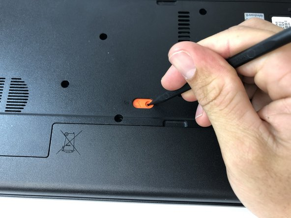 Using the spudger, push the orange tab to the unlock position.