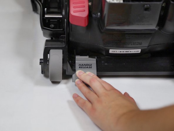 Press the handle release pedal and rotate the motor cover downward until it is fully reclined.