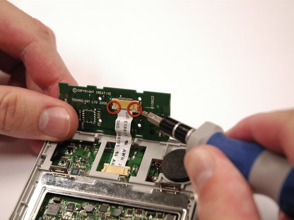 Image 1/2: Remove the ribbon cable from the keypad.