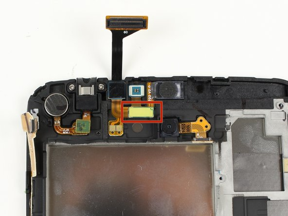 Once the plastic stopper is removed, use tweezers to remove the flat-topped connector for the front camera.