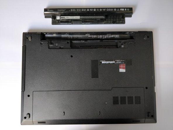 Verwijder de lader van de laptop.