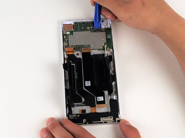 Wedge your iFixit opening tool under the motherboard.