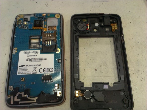 With a flat screwdriver or plastic opener,  separate the front case from the rear case. It will be easy!