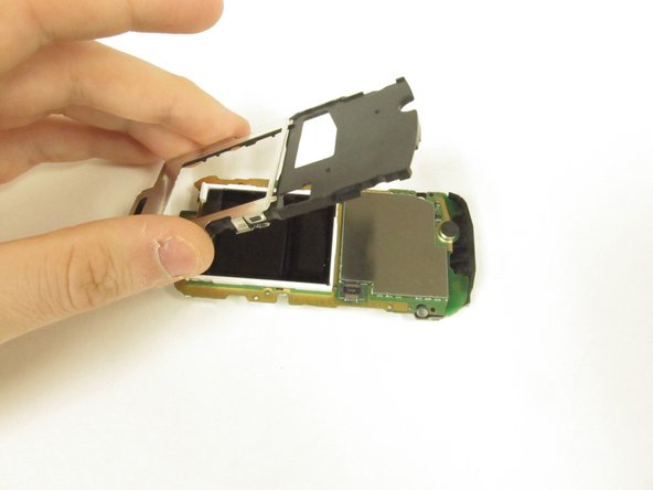 Gently remove the plastic and metal framework of the phone by lifting it up.