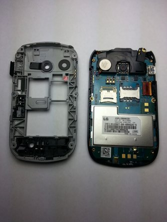 Using the plastic opening tool, pry off the shell of the phone, revealing the motherboard