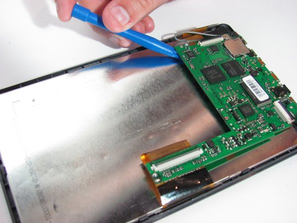 Use a spudger or plastic opening tool to lift up the motherboard.