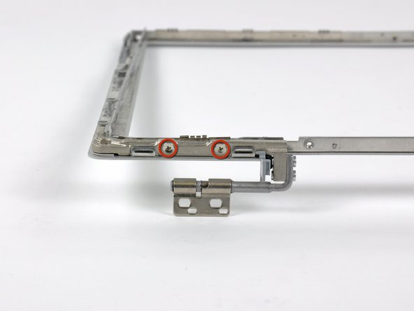 Remove the two 5.5 mm Phillips screws securing the right clutch cover to the front display bezel.