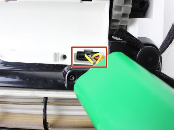 Use a flathead screwdriver to push down on the latch of the battery clip.