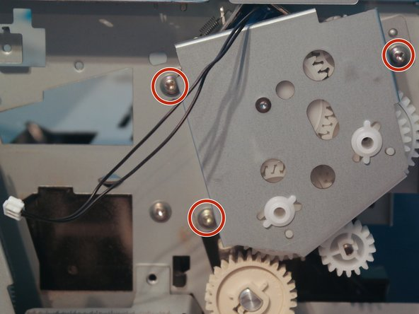 Remove 3 screws holding the duplexer gears to the printer and remove the gears.