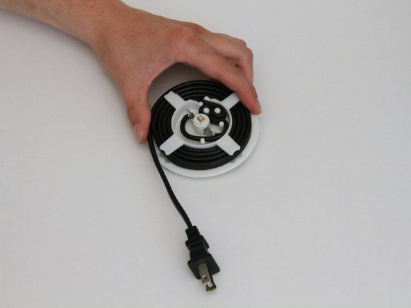 Carefully unwind the power cord from the spool.