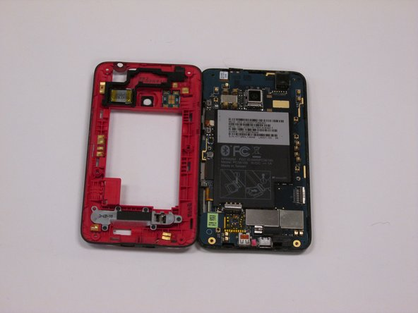 Image 3/3: Lift off the inner frame from the rest of the phone to remove it.