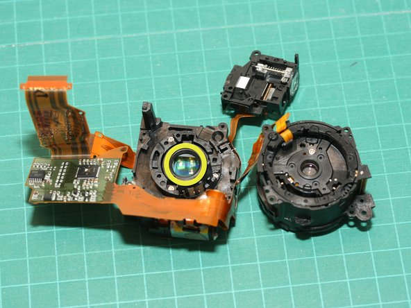 Here are the lens module with front and back halves separated. The sensor is under the rear lens element (yellow circle)