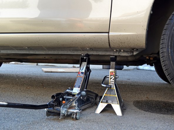 Image 2/3: Use the jack to raise the car enough to comfortably work under it.