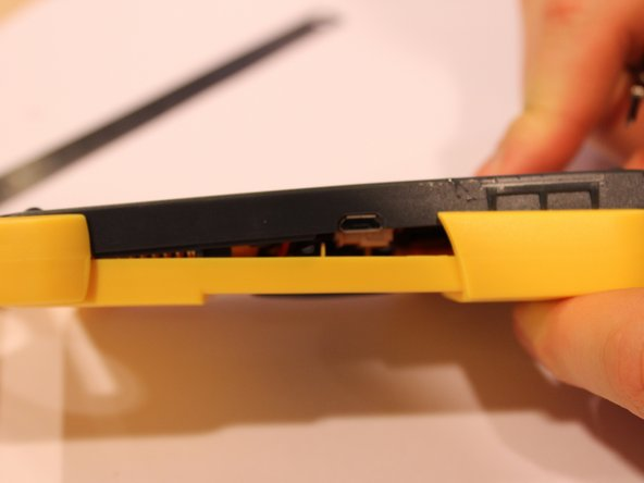 Carefully remove yellow casing.