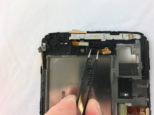 Remove camera by carefully lifting out of the device