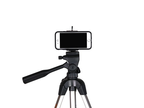 Mount your smartphone to a tripod to minimize camera shake. For crisp, clear shots, you need to keep the camera steady.