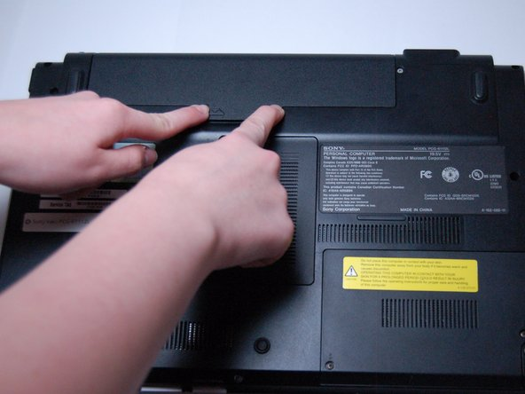 Slide both latches to the center of the laptop in order to release the battery.