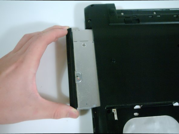 Image 1/2: Gently lift the rear plastic hinge cover to separate it from the laptop.