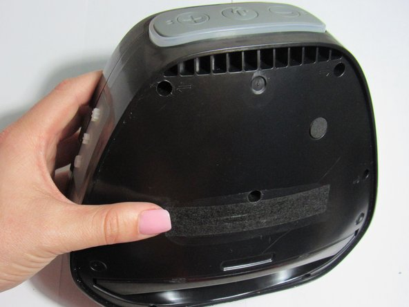 Orient speaker so volume buttons are facing away from you, and Bluetooth and power buttons are on the left-hand side.