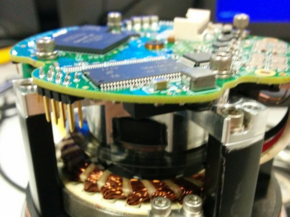 Image 1/1: Desolder the two copper coloured wires next to the thicker wires going to the motor stator. Make sure to label which wire goes where.