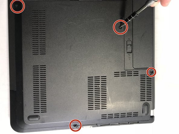 Start by using the 00 Phillips Head Screwdriver to unscrew the four 2mm screws protecting the right side of the bottom case.