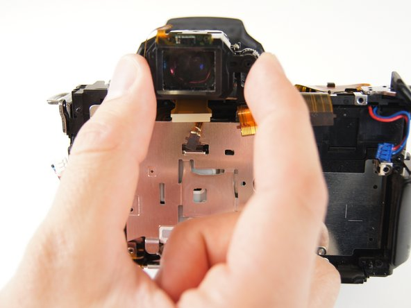 Image 1/3: Gently remove the eyepiece sensor from the viewfinder.