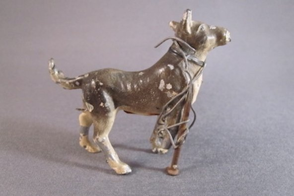 dog figurine fixed through home repair