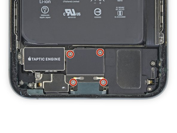 Use a Y000 driver to remove the four 1.2 mm screws securing the lower battery connector cover.