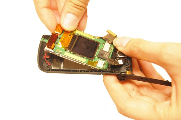Hold the outer phone casing and pull the LCD screen out.