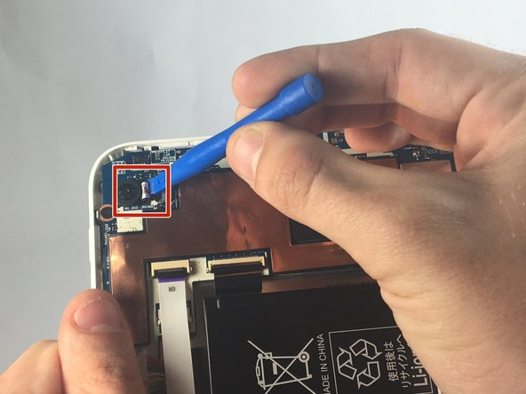 Remove the ribbon cord from its slot using a plastic opening tool.