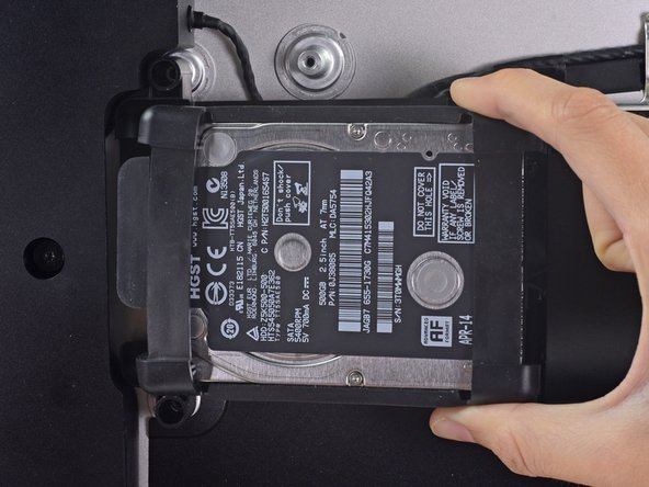 Image 3/3: The hard drive is attached by a single SATA power/data cable—do '''not''' attempt to fully remove it from the iMac yet.
