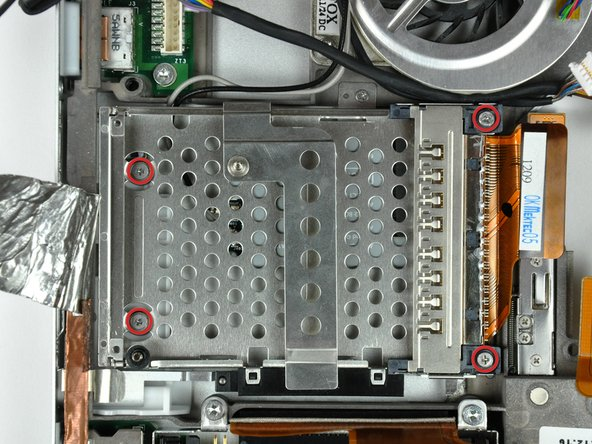 Image 1/2: The two longer shouldered screws belong in the end of the PC card cage closest to the logic board.
