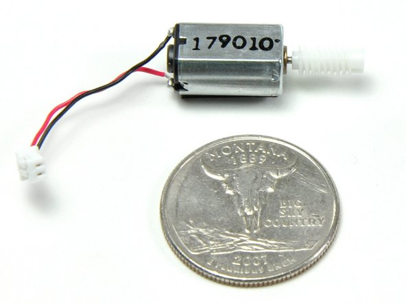 About the size of an American quarter, the base has a tiny motor with three fragile plastic gears. Barring overheating issues with the top unit, we're guessing this motor assembly will be the Kinect's weak point.