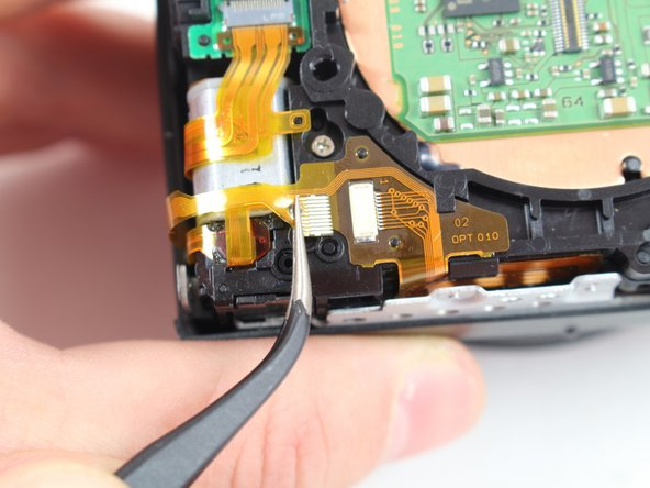Image 3/3: The bottom ribbon cable does not have a locking tab; it simply slides in and out.