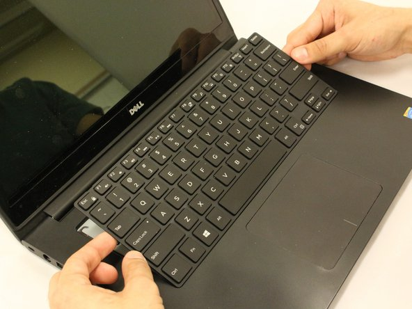 Once you have gently pryed each slit, slide the keyboard towards the screen at an angle for removal.