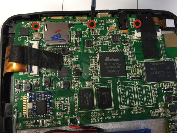 There are 3 Ph 00 screws (4 mm long) that connect the motherboard to the tablet. These screws are indicated in the image by special markers. Once you have located these screws, unscrew them.